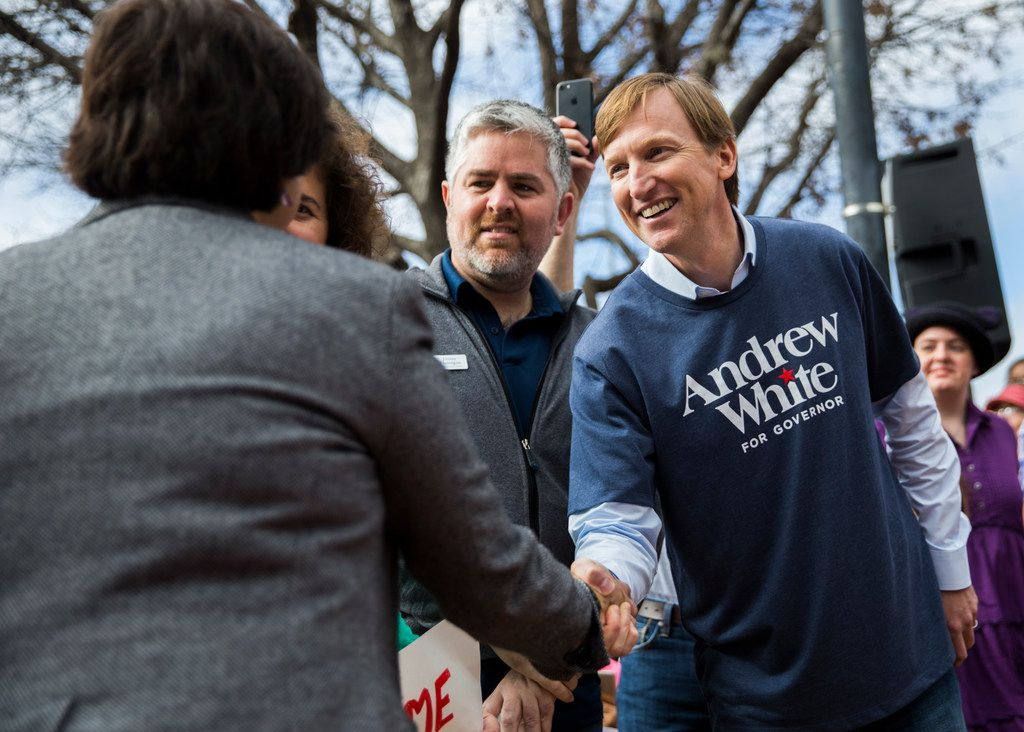 Gubernatorial candidate Andrew White, the son of former Texas Gov. Mark White, shakes hands with former Dallas County sheriff and fellow gubernatorial candidate Lupe Valdez as they are recognized before  the Austin Women's March on Jan. 20, 2018, in Austin.