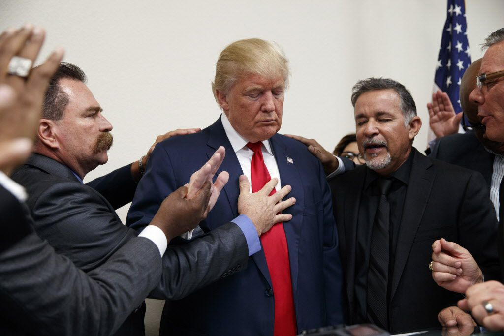 Pastors from the Las Vegas area pray with Republican presidential candidate Donald Trump during a visit to the International Church of Las Vegas, and International Christian Academy, Wednesday, Oct. 5, 2016, in Las Vegas.