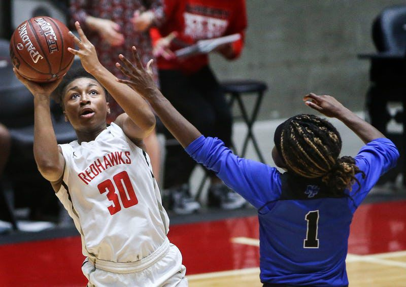Frisco Liberty's Jazzy Owens-Barnett (30) puts up a shot past Kaylin Smith (1) during the second half of a girls basketball Class 5A Region II semifinal between Frisco Liberty and North Forney on Friday, Feb. 22, 2019 at the Curtis Culwell Center in Garland, Texas. Frisco Liberty beat North Forney 39-25. (Ryan Michalesko/The Dallas Morning News)
