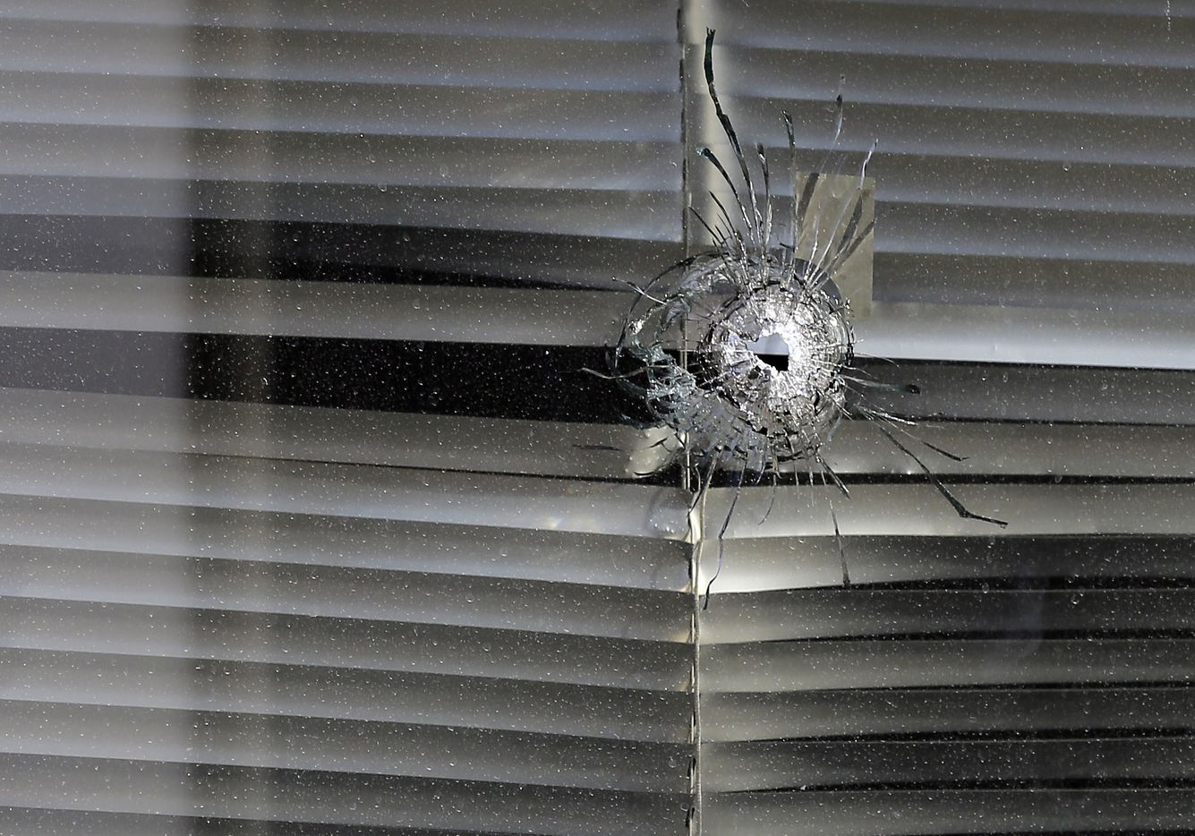 A bullet hole was seen in a window at El Centro College on July 14, 2016.