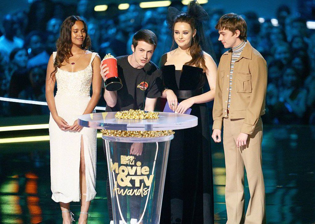 """13 Reasons Why"" stars Alisha Boe, Dylan Minette, Katherine Langford and Miles Heizer present the award for Best Kiss at the 2018 MTV Movie & TV Awards."