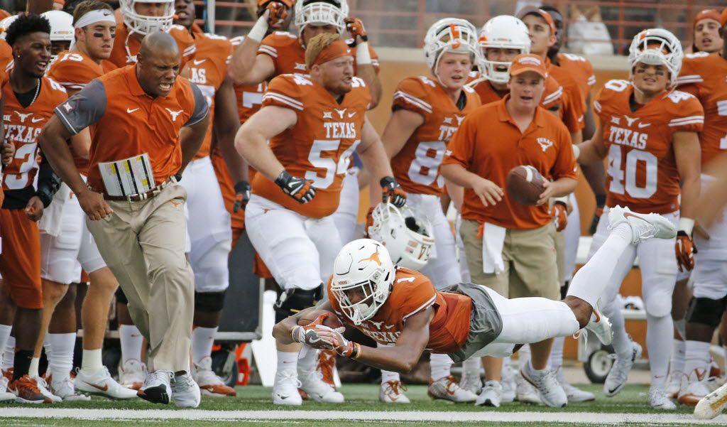 Texas wide receiver John Burt (1) dives for extra yardage along the sideline in front of the Longhorns bench in the first quarter during the Notre Dame Fighting Irish vs. the University of Texas Longhorns NCAA football game at Darrell K. Royal Memorial Stadium in Austin on Sunday, September 4, 2016. (Louis DeLuca/The Dallas Morning News)