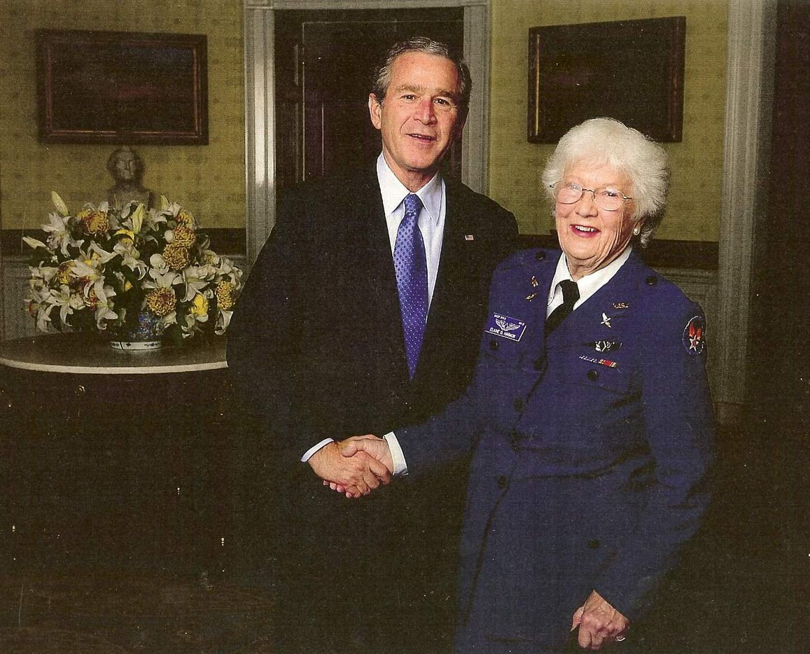 Elaine Harmon, left, shakes hands with President George W. Bush in 2007. Harmon was a member of the Women Airforce Service Pilots, or WASP, during World War II. On Tuesday, Nov. 13, Harmon's granddaughter Erin Miller will be in Austin to testify against the Texas State Board of Education's decision to eliminate the WASP from the public school social studies curriculum.