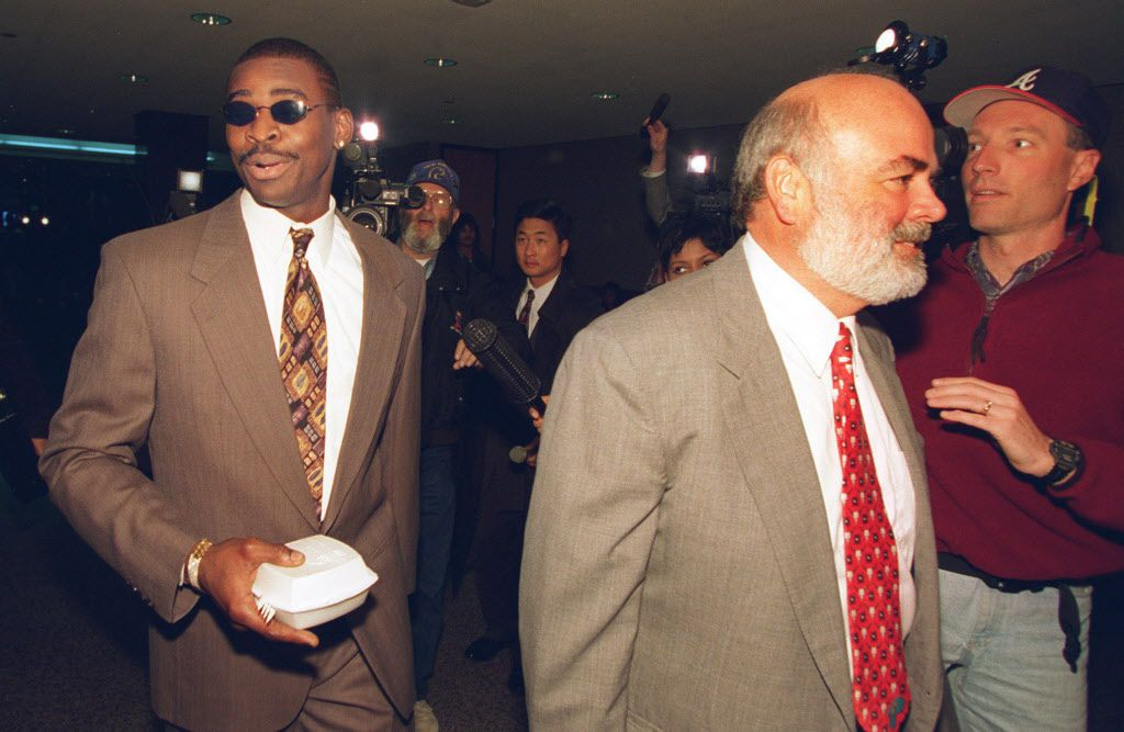 3-28-1996...Michael Irvin (L), walks with his attorney Kevin Clancy, (R), Thursday, at the Frank Crowley  Crininal Courts building. Michael Irvin is a witness in a drug  case filed aganist Angela Beck, who was arrested on March 4 in  Irving.