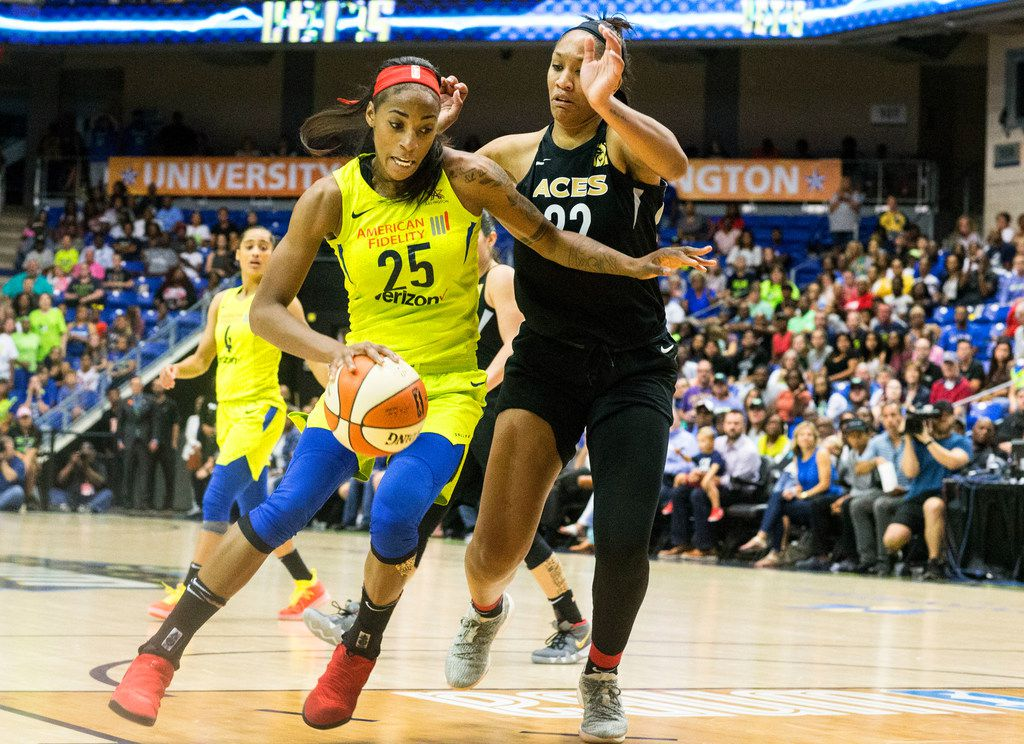 Dallas Wings forward Glory Johnson (25) dribbles the ball past Las Vegas Aces forward A'ja Wilson (22) during game against the Las Vegas Aces at College Park Center in Arlington, Texas on Aug. 17, 2018. The Wings defeated the Aces, 107-102. (Carly Geraci/The Dallas Morning News)