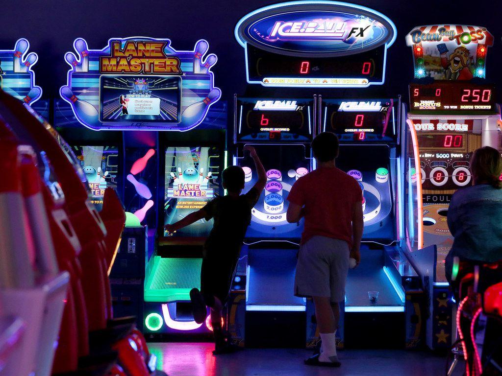 Kids play arcade games at NickelRama in Garland.