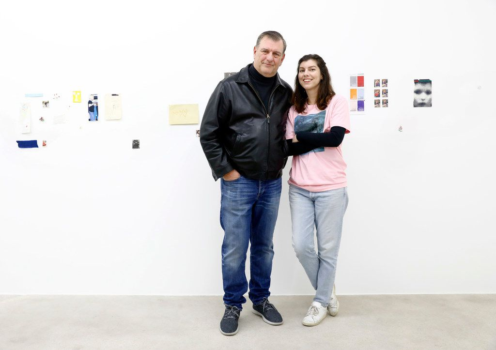 Artist Michelle Rawlings poses with her father, Dallas Mayor Mike Rawlings in front of her Untitled mixed media mural at a 2018 exhibition at AndNow Gallery in Dallas.