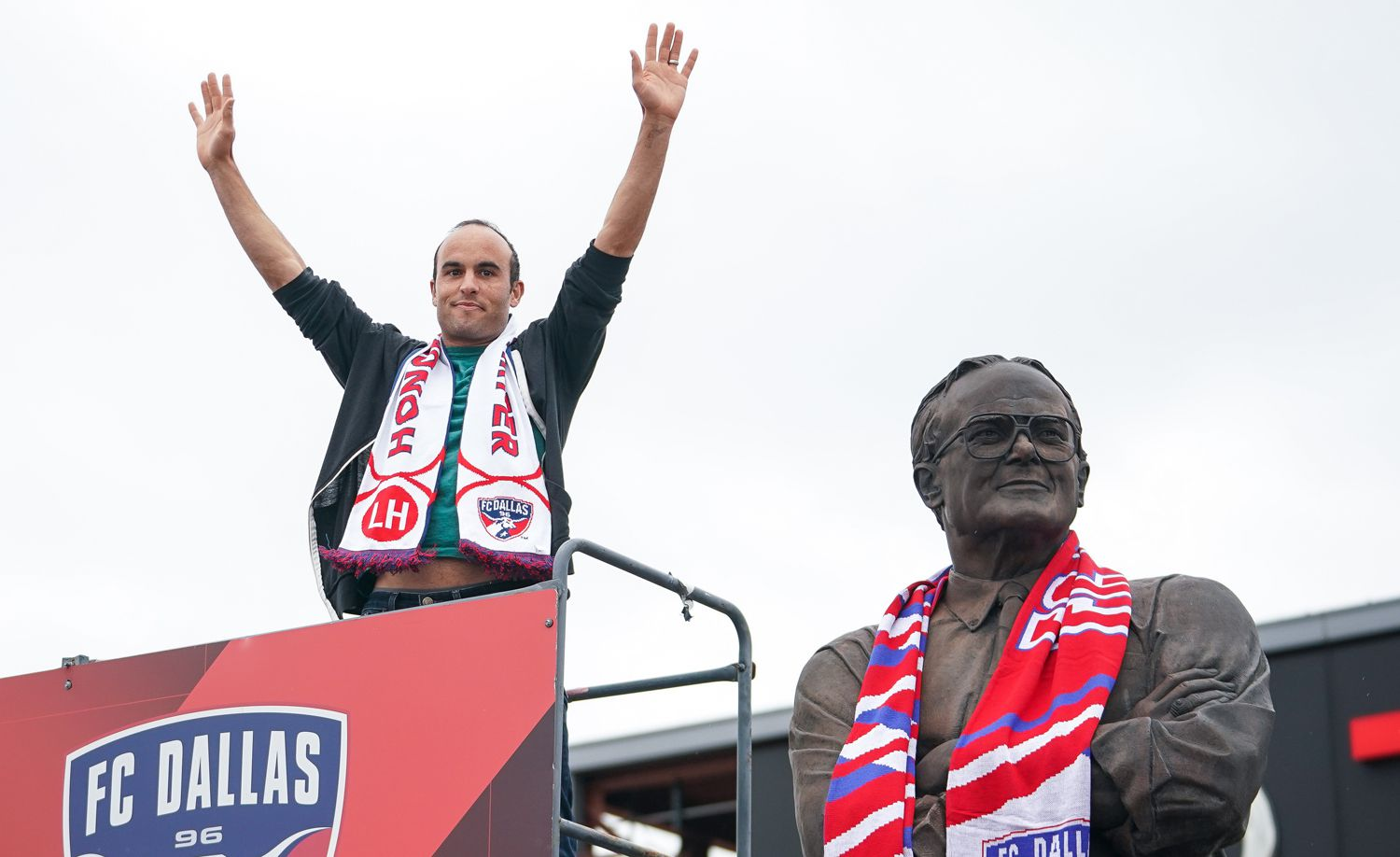 Former US Soccer star and current Dan Diego Socker Landon Donovan scarfs the Lamar Hunt statue at the FC Dallas game against Colorado Rapids.  (3-23-19)