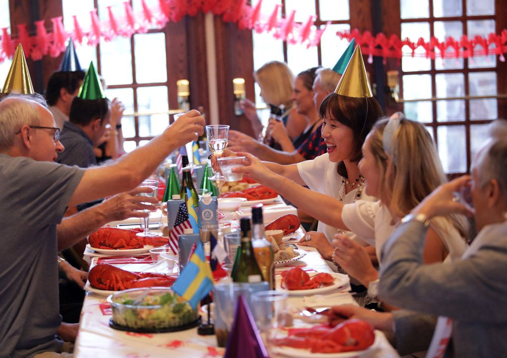 Guests enjoy traditional Swedish food and drinks during the Swedish American Chamber of Commerce Swedish lobster feast at the Heritage Lakes Club House in Frisco on Sept. 7, 2019.