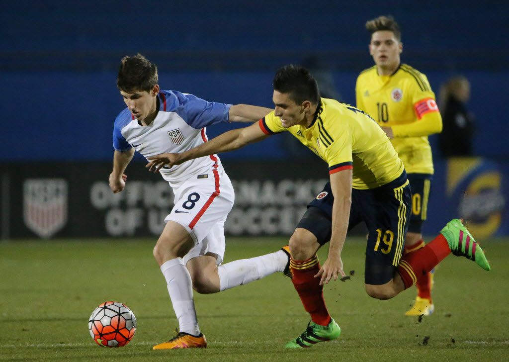 United States midfielder Emerson Hyndman (8) and Colombia midfielder Guillermo Celis (19) make a play for the ball in the second half during the second leg of the 2016 Olympic qualifying playoff between the United States U-23 Men's National Team and Colombia at Toyota Stadium, in Frisco, Texas Tuesday March 29, 2016. Colombia beat the United States 2-1. (Andy Jacobsohn/The Dallas Morning News)