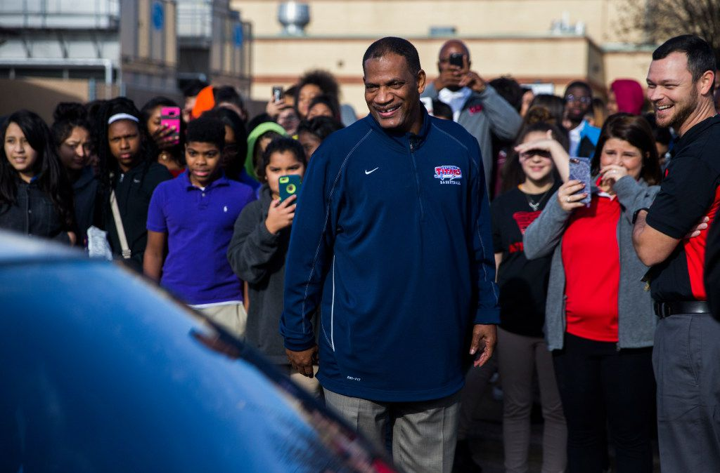 Coach Kevin MaBone is surprised with a car during a presentation by students and teachers on Friday outside Wilkinson Middle School in Mesquite.