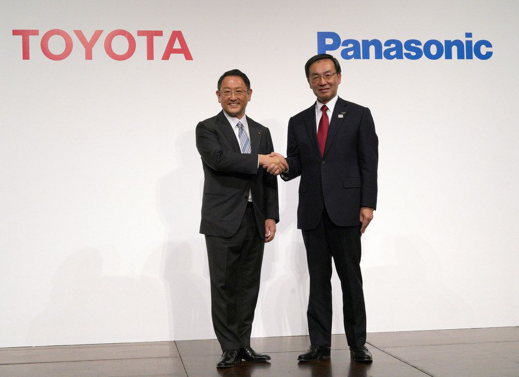 Toyota Motor Corporation President Akio Toyoda (left) and Panasonic Corporation President Kazuhiro Tsuga, pose for photographers after a joint press conference in Tokyo. Toyota Motor Corp. and Panasonic Corp. said in a joint statement Tuesday that they are setting up a joint venture to research, manufacture and sell batteries for ecological autos, an increasingly lucrative sector amid concerns about global warming.