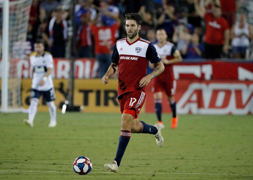 FC Dallas defender Ryan Hollingshead handles the ball during an MLS soccer match against the Vancouver Whitecaps in Frisco, Texas, Wednesday, June 26, 2019. (AP Photo/Tony Gutierrez)