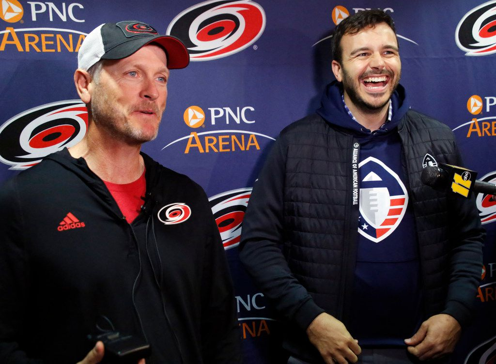 Tom Dundon, left, majority owner of the Carolina Hurricanes, and Charlie Ebersol, co-founder and CEO of the Alliance of American Football, talked with the media in February in Raleigh, N.C., when the Dallas billionaire rescued the struggling league.