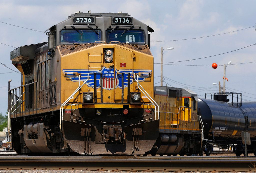 FILE - In this June 6, 2014, file photo, Union Pacific locomotives pull a train in Council Bluffs, Iowa. Union Pacific expects to haul less freight in the second half of the year than it previously predicted, which isn't a good sign for the economy. (AP Photo/Nati Harnik, File)