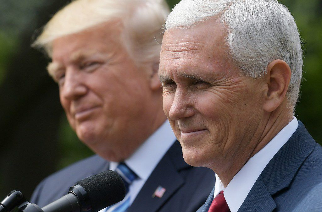 US Vice President Mike Pence (R) speaks while standing next to US President Donald Trump during a ceremony before the signing of an Executive Order on Promoting Free Speech and Religious Liberty in the Rose Garden of the White House on May 4, 2017 in Washingon. / AFP PHOTO / MANDEL NGANMANDEL NGAN/AFP/Getty Images