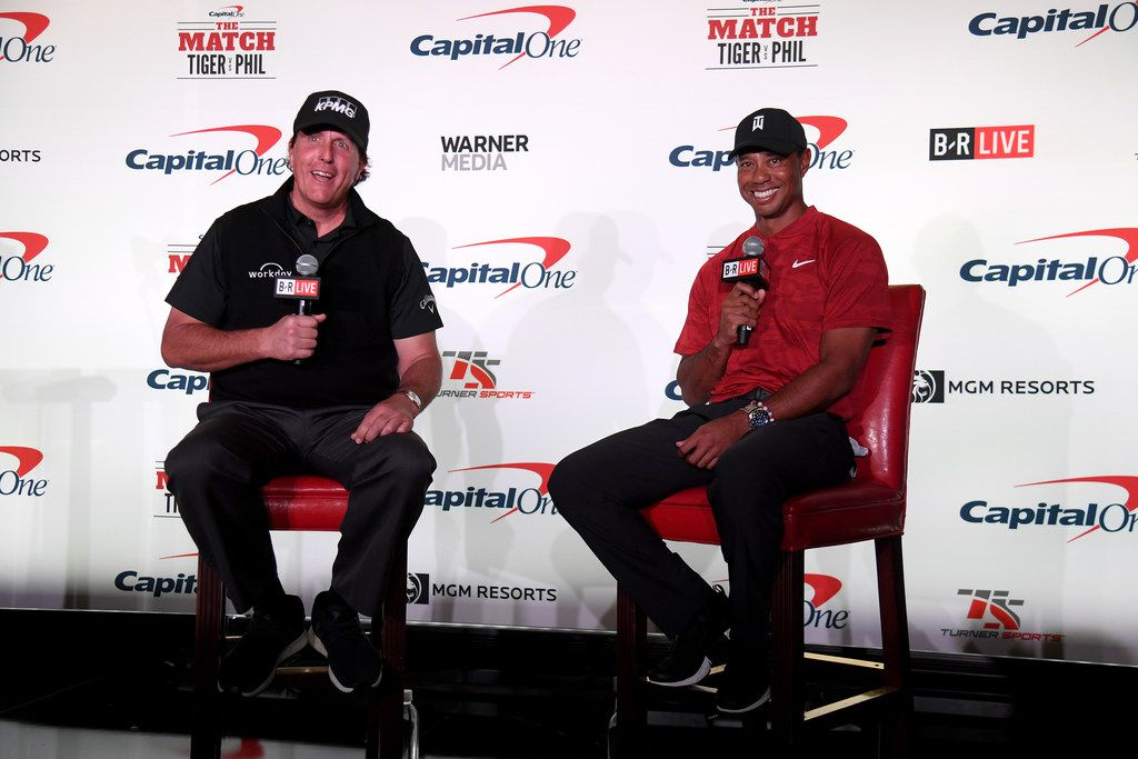 Phil Mickelson and Tiger Woods speak with the media during a press conference before The Match at Shadow Creek Golf Course in Las Vegas.