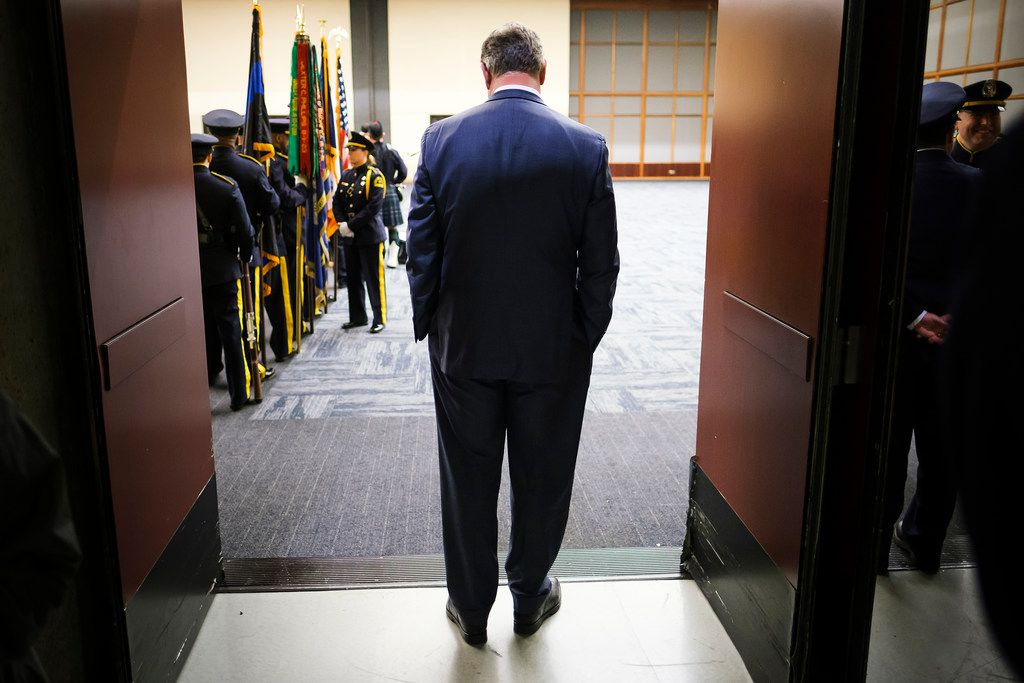 Dallas Mayor Mike Rawlings waits in a doorway for the Dallas Police memorial service, honoring officers who lost their lives in the line of duty, to begin at the Kay Bailey Hutchison Convention Center on May 8, 2019. (Smiley N. Pool/The Dallas Morning News)