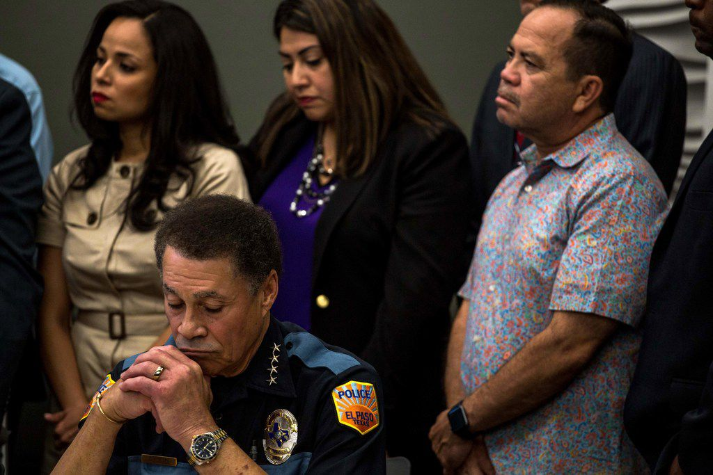 El Paso Police Chief Greg Allen (L) listens during a press briefing, following a mass fatal shooting, at the El Paso Regional Communications Center in El Paso, Texas, on August 3, 2019. - A gunman armed with an assault rifle killed 20 people Saturday when he opened fire on shoppers at a packed Walmart store in the latest mass shooting in the United States.