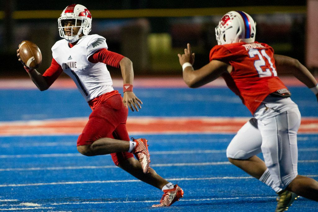 Bishop Dunne quarterback Simeon Evans (1) attempts to evade Parish Episcopal line backer Keegon Addison (21) during the football game between Parish Episcopal High School and Bishop Dunne Catholic School at the Gloria H. Snyder Stadium in Farmers Branch, Texas, on Friday, Oct. 11, 2019. (Lynda M. Gonzalez/The Dallas Morning News)