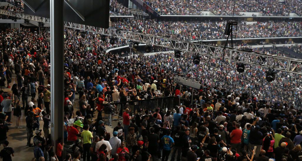 WWE fans fill the party pass zone before WrestleMania 32 at AT&T Stadium in Arlington, TX, Sunday, April 3, 2016. (David Guzman/The Dallas Morning News)