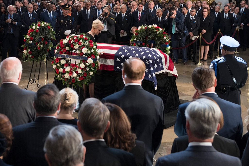 Cindy McCain stands beside the flag-draped casket bearing the remains of her husband, Sen. John McCain, R-Ariz., Friday, Aug. 31, 2018 in the U.S. Capitol in Washington.