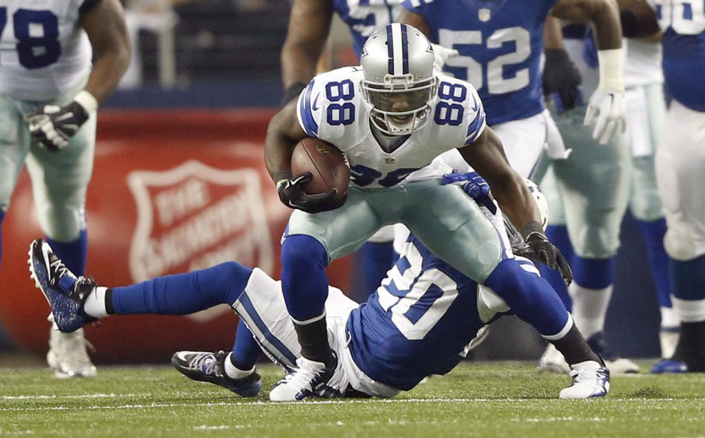 Dallas Cowboys wide receiver Dez Bryant (88) attempts to shake Indianapolis Colts cornerback Darius Butler (20) on a pass play during the first half of play at AT&T Stadium in Arlington, Texas on Sunday, December 21, 2014. (Vernon Bryant/The Dallas Morning News)