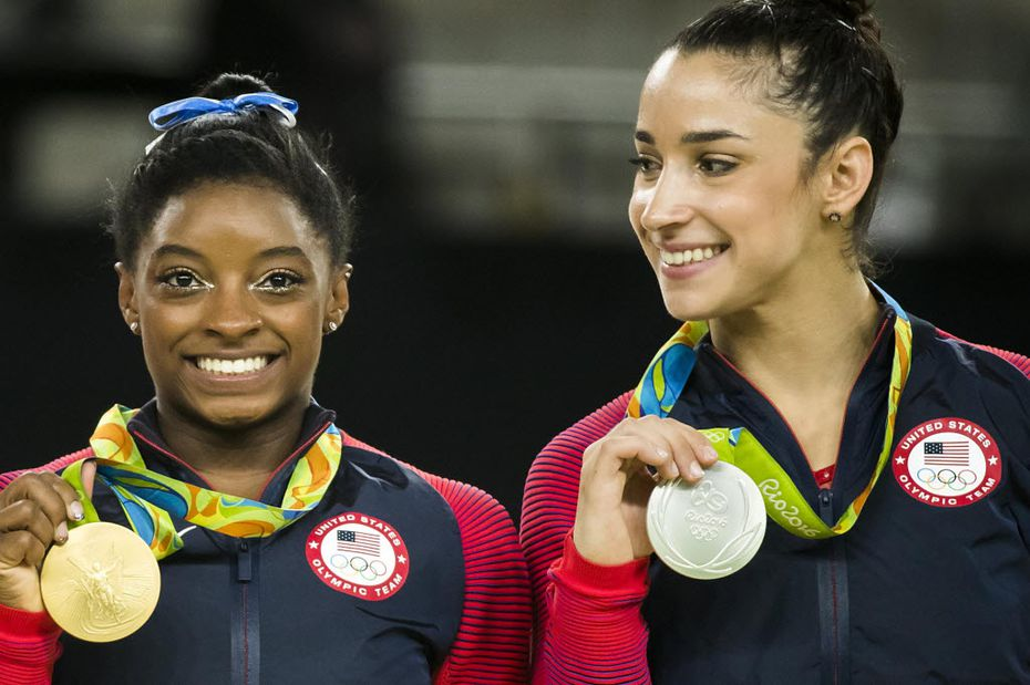 Simone Biles and Aly Raisman of the United States show off their gold and silver medals after the women's gymnastics all-around final at the Rio 2016 Olympic Games on Thursday, Aug. 11, 2016, in Rio de Janeiro.