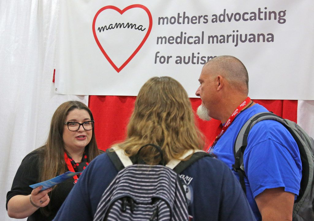 Michelle Walker, left, talks with delegates at the MAMMA (mothers advocating medical marijuana for autism) booth during the 2018 Texas GOP Convention held at the Henry B. Gonzalez Convention Center in downtown San Antonio. Texas on Thursday, June 14, 2018.