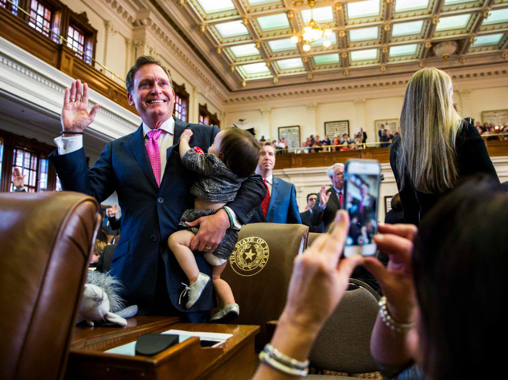 Texas State Rep. John Zerwas was sworn in while holding Tinley Zerwas, 1, during the first day of the 85th Texas Legislative Session on Jan. 10, 2017, at the Capitol in Austin.  (Ashley Landis/The Dallas Morning News)