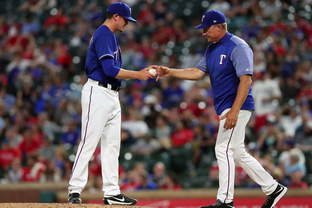 ARLINGTON, TX - SEPTEMBER 14:  Jeff Banister #28 of the Texas Rangers pulls Nick Gardewine #45 of the Texas Rangers from the game against the Seattle Mariners in the top of the sixth inning at Globe Life Park in Arlington on September 14, 2017 in Arlington, Texas.  (Photo by Tom Pennington/Getty Images)