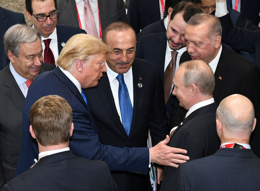 President Donald Trump (center left) talks with Russian President Vladimir Putin (center right) as they and Turkey's President Recep Tayyip Erdogan (top right) and U.N. Secretary-General Antonio Guterres (left) attend the G-20 summit in Osaka, Japan, on June 29, 2019. (Presidential Press Service via the Associated Press)