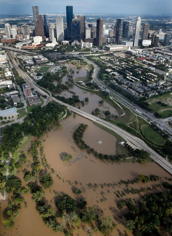 The swollen Buffalo Bayou is seen with the Houston skyline as a backdrop on Aug. 30, 2017. Hurricane Harvey inundated the Houston area with several feet of rain.