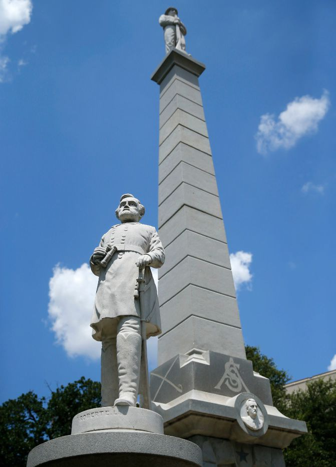 """A statue of Gen. Robert E. Lee (bottom) stands at The Confederate War Memorial honoring Confederate soldiers who died in the Civil War at Pioneer Park Cemetery in downtown Dallas, Tuesday, July 18, 2017. A statue of a Confederate solider stands on top, facing the south. At the monument's base are statues of Lee, along with Confederate President Jefferson Davis, Gen. Thomas """"Stonewall"""" Jackson, and Gen. Albert Sidney Johnston."""