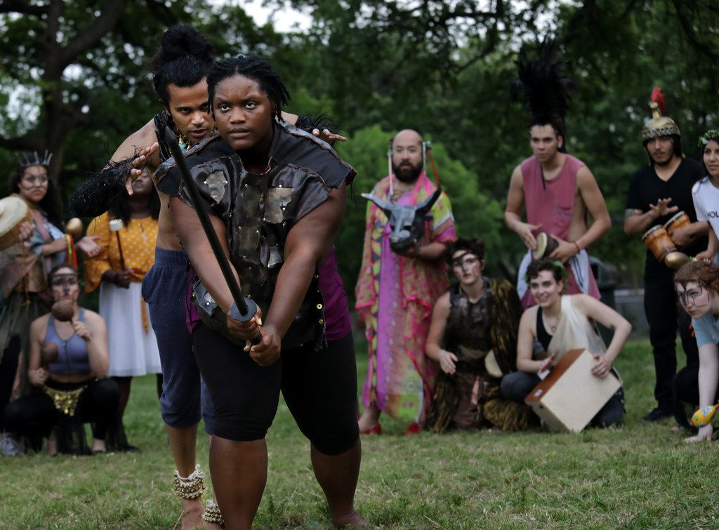 Raymond Govender (left), Dencia Baltimore and other cast members of Giant Entertainment's City Dionysia festival rehearse at Kidd Springs Park. The three-day festival at Annette Strauss Square includes a production of the ancient Greek play The Bacchae