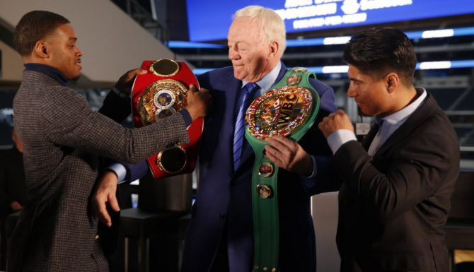 Boxers Errol Spence Jr. (left) and Mikey Garcia adorn Dallas Cowboys owner Jerry Jones with their championship belts during a press conference for the Premier Boxing Champions fight between Unbeaten IBF Welterweight World Champion Errol Spence Jr. and undefeated four-division world champion Mikey Garcia at AT&T Stadium on Tuesday, Feb. 19, 2019. The match will take place at AT&T Stadium on March 16, 2019.  (Rose Baca/Staff Photographer)