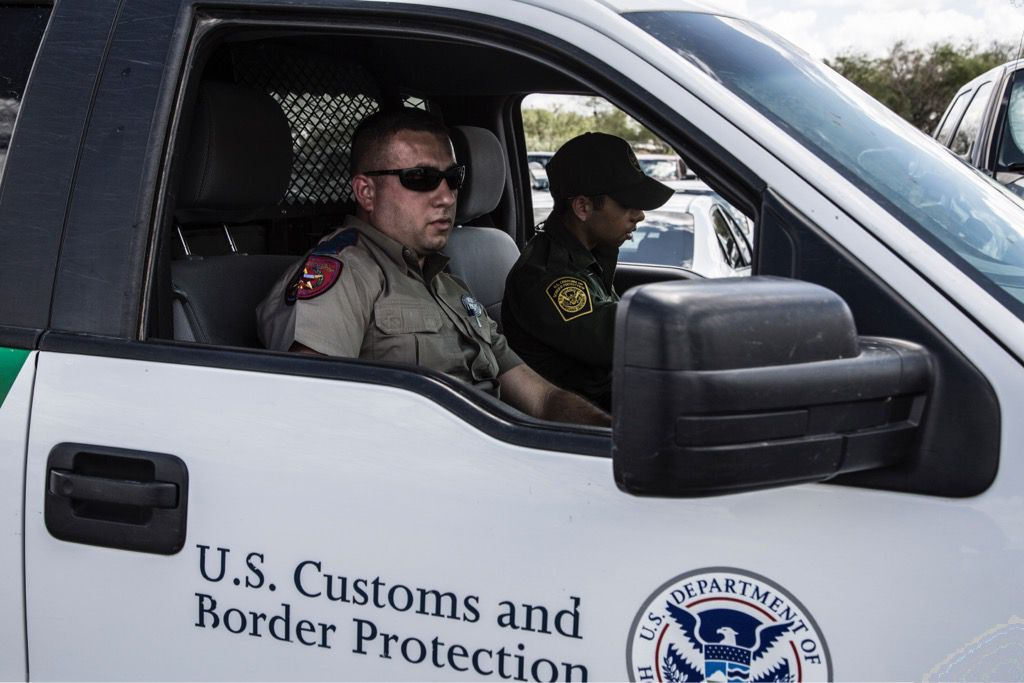 A Texas Department of Public Safety trooper rides with a U.S. Border Patrol agent in a so-called Cortina unit. About 10 of the joint units work the Rio Grande Valley every shift. (Department of Public Safety)