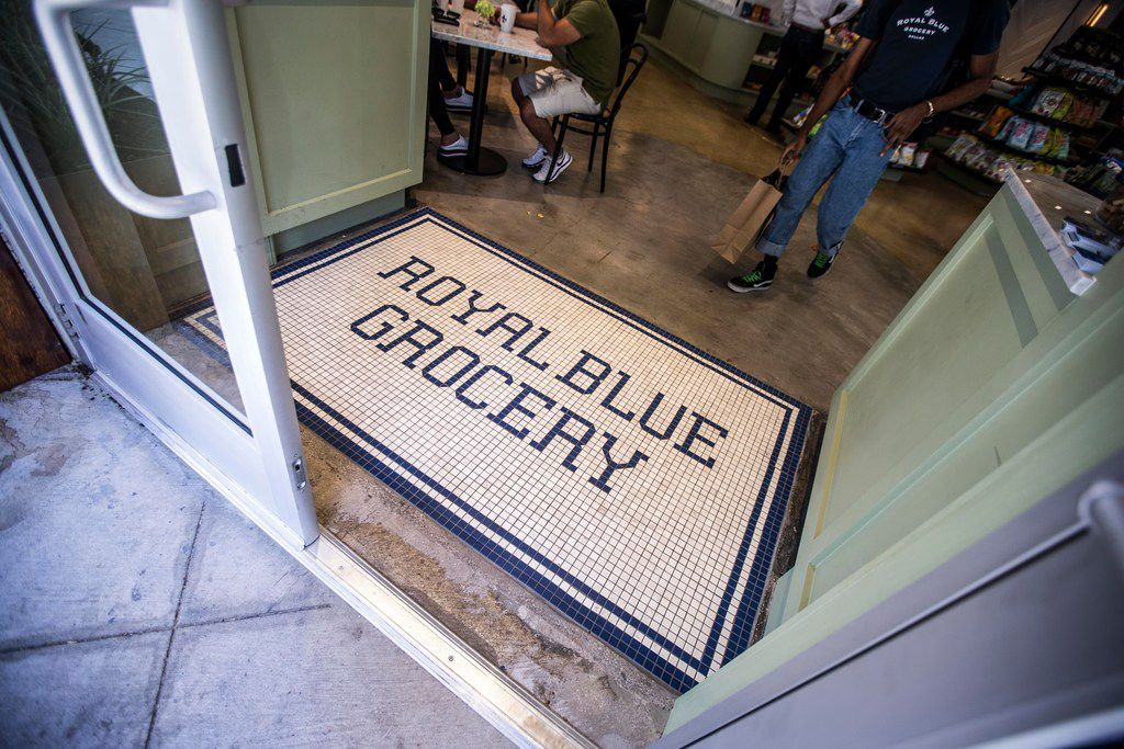 A man walks out of the store at Royal Blue Grocery in Dallas, The store opened its downtown location last week.