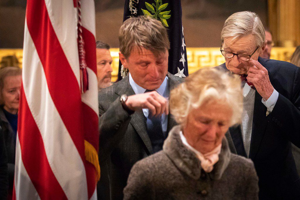 Jonathan J. Bush the brother of the former President, (right) wipes a tear as visits the flag-draped casket of President George H.W. Bush with the former President's nephew Jonathan S. Bush and sister Nancy Walker Bush Ellis as he lies in the Rotunda of the U.S. Capitol on Tuesday, Dec. 4, 2018, in Washington.