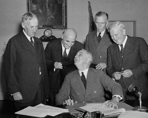President Franklin D. Roosevelt signs America's first peacetime draft law in the Cabinet Room of the White House in Washington Sept. 16, 1940. Standing from, left, are, Secetary of War Henry L. Stimson; Rep. Andrew J. May, D-Ky., House Military Affairs Committee Chairman; Gen. George C. Marshall, Army Chief of Staff; and Sen. Morris Sheppard, D-Texas, Senate Military Committee Chairman.  (AP Photo)
