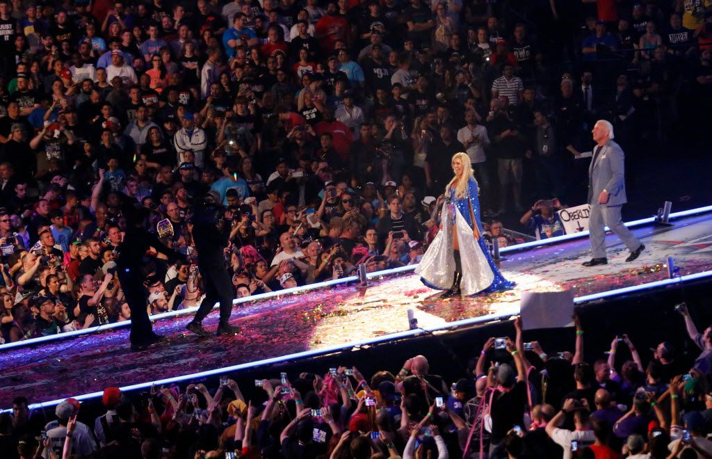 WWE Diva Charlotte is introduced to the crowd followed by Rick Flair before the Divas Championship Triple Threat at WrestleMania 32 at AT&T Stadium in Arlington, TX, Sunday, April 3, 2016. (David Guzman/The Dallas Morning News)