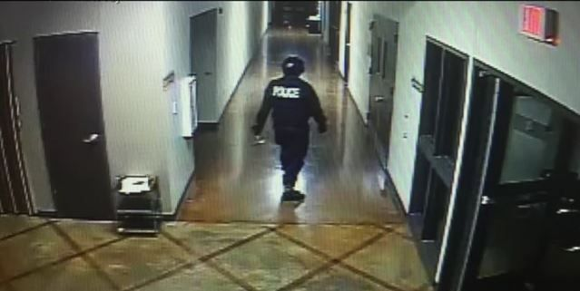 A screen shot from surveillance footage shows the suspect inside Creekside Church of Christ.