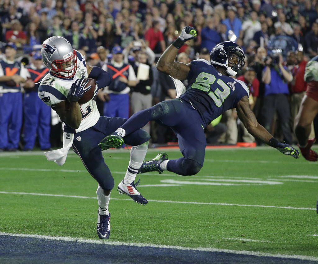 New England Patriots strong safety Malcolm Butler (21) intercepts a pass intended for Seattle Seahawks wide receiver Ricardo Lockette (83) during the second half of NFL Super Bowl XLIX football game Sunday, Feb. 1, 2015, in Glendale, Ariz. (AP Photo/Kathy Willens) 02022015xSPORTS
