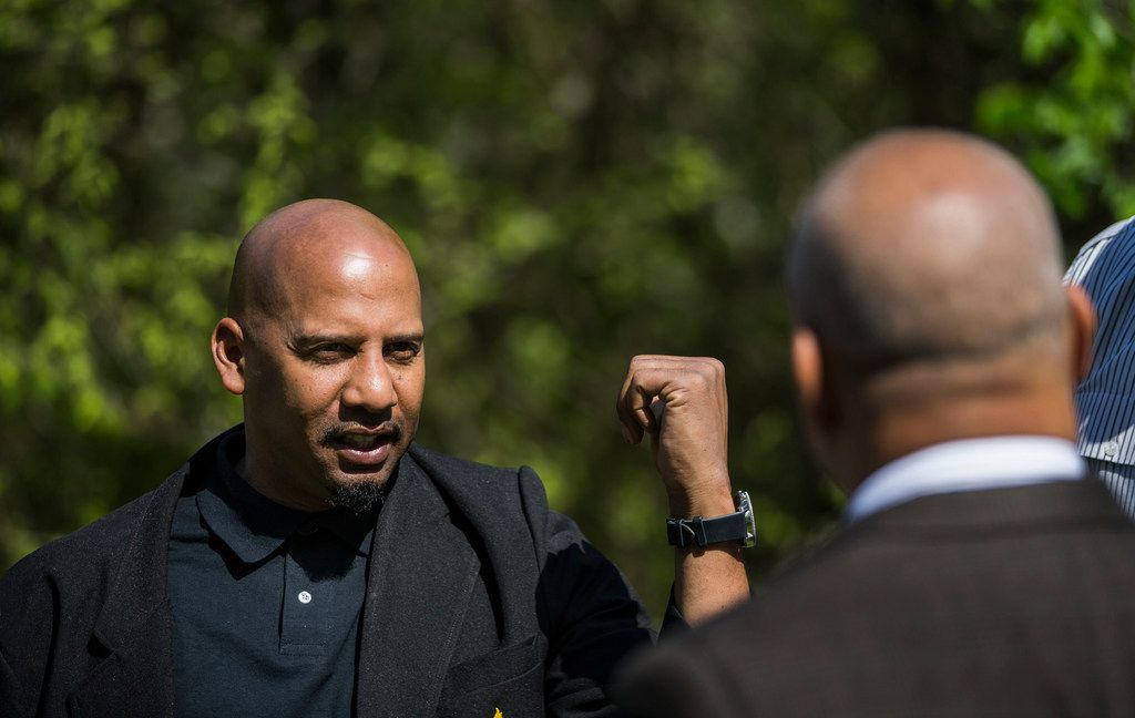 Willie F. Johnson Jr. (left), principal of South Oak Cliff High School, speaks with property owner Randy Bowman at an undeveloped Bowman property where students walk to and from school along Five Mile Creek in Dallas.