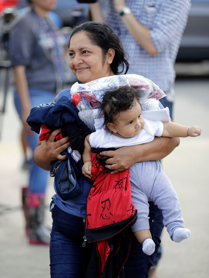 Immigrant Maria Del Carmen Barrios, from Guatemala, carries her six-month-old son Jose as they arrive at the bus station after they were processed and released by U.S. Customs and Border Protection, Friday, June 22, 2018, in McAllen, Texas. She was separated from her younger sister when they were taken in by officials and does not know where she is now.
