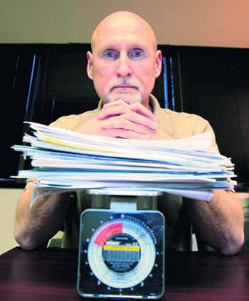 Paperwork has overwhelmed Jimmie Hughes, who received an $8,100 American Recovery Capital loan for his Richardson-based telemarketing firm, Grand America.
