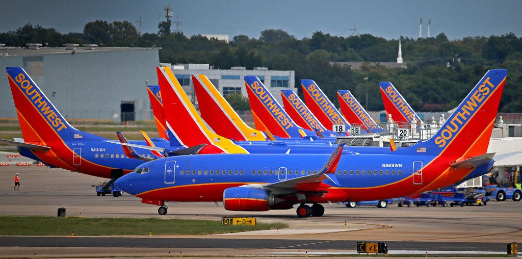 A Southwest Airlines airplane taxis past other Southwest Airlines airplanes at Love Field Airport in Dallas, Tuesday, Sept. 12, 2017. (Jae S. Lee/The Dallas Morning News)