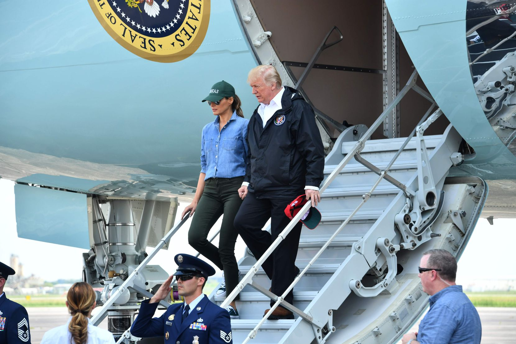 President Donald Trump and first lady Melania Trump arrive at  Ellington Field in Houston Saturday.