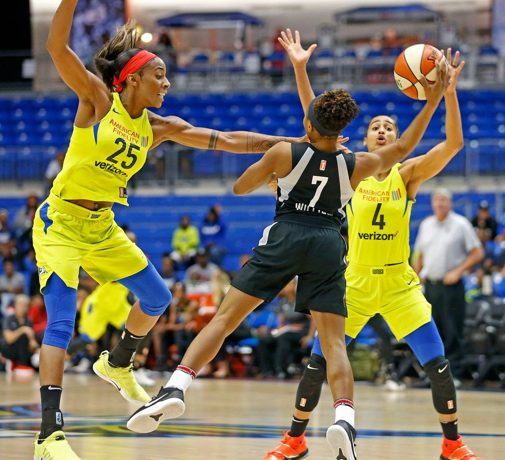 Las Vegas Aces guard Morgan William (7) is defended by Dallas Wings forward Glory Johnson (25) and guard Skylar Diggins-Smith during the first half at College Park Center in Arlington, Texas, Sunday, May 13, 2018. (Jae S. Lee/The Dallas Morning News)