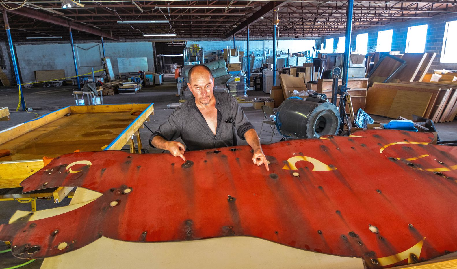 Michael Van Enter worked on the restoration of the original Dallas Pegasus sign, which stood on top of the Magnolia building from the 1930s until 1999.
